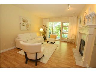 "Photo 1: 210A 301 MAUDE Road in Port Moody: North Shore Pt Moody Condo for sale in ""HERITAGE GRAND"" : MLS®# V1083128"