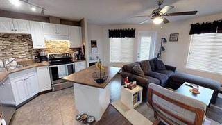 Photo 1: 217 111 EDWARDS Drive in Edmonton: Zone 53 Condo for sale : MLS®# E4211505