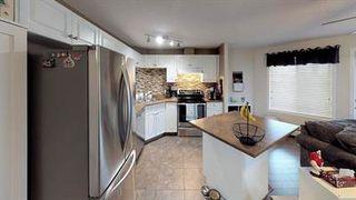 Photo 3: 217 111 EDWARDS Drive in Edmonton: Zone 53 Condo for sale : MLS®# E4211505