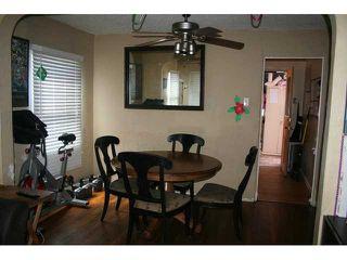 Photo 4: LEMON GROVE House for sale : 4 bedrooms : 7462 Daytona Street