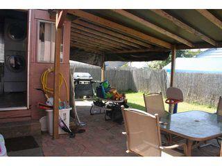 Photo 9: LEMON GROVE House for sale : 4 bedrooms : 7462 Daytona Street