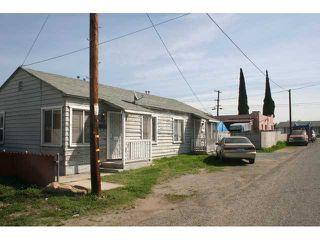 Photo 11: LEMON GROVE House for sale : 4 bedrooms : 7462 Daytona Street