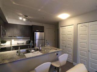 Photo 2: 506 13883 LAUREL Drive in Surrey: Whalley Condo for sale (North Surrey)  : MLS®# R2463277