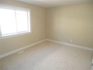 Photo 8: 3412 GISLASON AV in Coquitlam: Burke Mountain House for sale : MLS®# V1020753