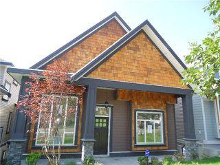 Photo 1: 3412 GISLASON AV in Coquitlam: Burke Mountain House for sale : MLS®# V1020753
