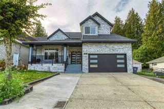Photo 1: 6265 134 Street in Surrey: Panorama Ridge House for sale : MLS®# R2518131