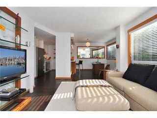 "Photo 1: # 301 1510 W 1ST AV in Vancouver: False Creek Condo for sale in ""MARINER POINT"" (Vancouver West)  : MLS®# V1026400"