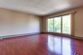Photo 3: 8 916 3 Avenue NW in Calgary: Sunnyside Condo for sale : MLS®# C3629661