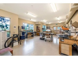 "Photo 7: 406 13870 70 Avenue in Surrey: East Newton Condo for sale in ""CHELSEA GARDENS"" : MLS®# R2450368"