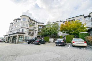 """Photo 2: 411 5759 GLOVER Road in Langley: Langley City Condo for sale in """"College Court"""" : MLS®# R2508133"""