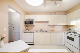 """Photo 19: 411 5759 GLOVER Road in Langley: Langley City Condo for sale in """"College Court"""" : MLS®# R2508133"""