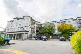"""Photo 1: 411 5759 GLOVER Road in Langley: Langley City Condo for sale in """"College Court"""" : MLS®# R2508133"""