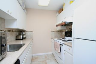 "Photo 10: 207 4950 MCGEER Street in Vancouver: Collingwood VE Condo for sale in ""Carleton"" (Vancouver East)  : MLS®# V974793"