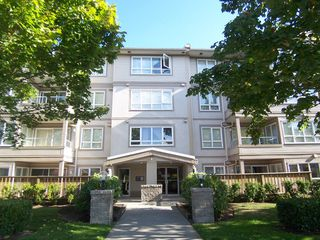 "Photo 1: 207 4950 MCGEER Street in Vancouver: Collingwood VE Condo for sale in ""Carleton"" (Vancouver East)  : MLS®# V974793"