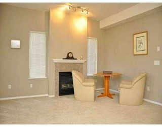 Photo 2: 205 3000 RIVERBEND Drive in Coquitlam: Coquitlam East House for sale : MLS®# V978175