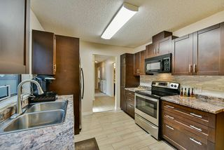 Photo 2: 101 7064 133B Street in Surrey: West Newton Townhouse for sale : MLS®# R2410637