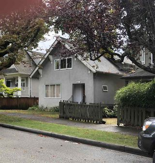 Photo 1: 1560 E 11TH Avenue in Vancouver: Grandview Woodland House for sale (Vancouver East)  : MLS®# R2485124