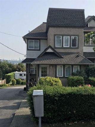 Photo 1: 1216 HACHEY Avenue in Coquitlam: Maillardville Townhouse for sale : MLS®# R2443433