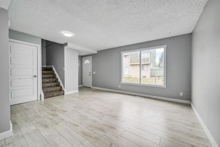 Photo 5: 129 405 64 Avenue NE in Calgary: Thorncliffe Row/Townhouse for sale : MLS®# A1037225