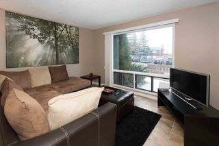 Photo 1: Condo for Sale in Southwest Calgary Palliser
