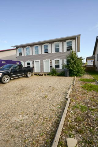 Photo 2: 7921 88 Avenue in Fort St. John: House 1/2 Duplex for sale