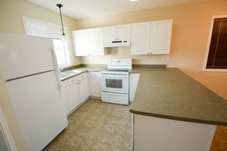 Photo 3: 7921 88 Avenue in Fort St. John: 1/2 Duplex for sale