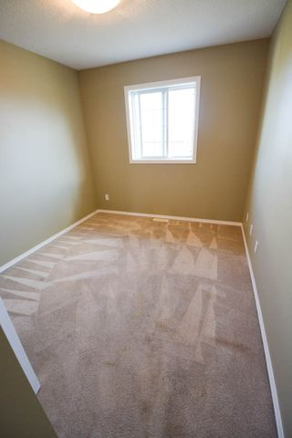 Photo 9: 7921 88 Avenue in Fort St. John: 1/2 Duplex for sale