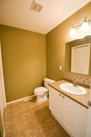Photo 4: 7921 88 Avenue in Fort St. John: 1/2 Duplex for sale