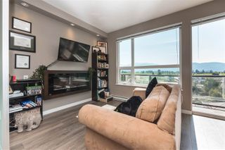 """Photo 1: 407 2242 WHATCOM Road in Abbotsford: Abbotsford East Condo for sale in """"Waterleaf"""" : MLS®# R2399795"""