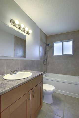 Photo 12: 2439 42 Street in Calgary: Forest Lawn Detached for sale : MLS®# A1022830