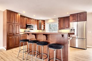 Photo 5: 4407 Dalgetty Hill NW in Calgary: Dalhousie Detached for sale : MLS®# A1042411