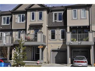Main Photo: 64 WINDSTONE Green SW: Airdrie Townhouse for sale : MLS®# C3566494