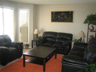 Photo 2: 12 SADDLEBROOK Link NE in CALGARY: Saddleridge Residential Detached Single Family for sale (Calgary)  : MLS®# C3559564