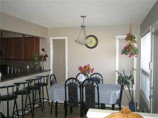 Photo 5: 12 SADDLEBROOK Link NE in CALGARY: Saddleridge Residential Detached Single Family for sale (Calgary)  : MLS®# C3559564