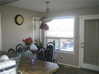 Photo 9: 12 SADDLEBROOK Link NE in CALGARY: Saddleridge Residential Detached Single Family for sale (Calgary)  : MLS®# C3559564