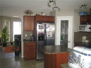 Photo 7: 12 SADDLEBROOK Link NE in CALGARY: Saddleridge Residential Detached Single Family for sale (Calgary)  : MLS®# C3559564