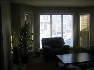 Photo 3: 12 SADDLEBROOK Link NE in CALGARY: Saddleridge Residential Detached Single Family for sale (Calgary)  : MLS®# C3559564