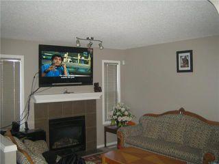Photo 4: 12 SADDLEBROOK Link NE in CALGARY: Saddleridge Residential Detached Single Family for sale (Calgary)  : MLS®# C3559564