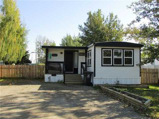 "Photo 1: 8819 75TH Street in Fort St. John: Fort St. John - City SE Manufactured Home for sale in ""ANNEOFIELD"" (Fort St. John (Zone 60))  : MLS®# N230729"
