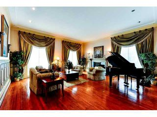 Photo 2: 950 BEND Court in Coquitlam: Harbour Chines House for sale : MLS®# V995881