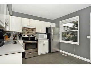 Photo 6: 553 REGAL Park NE in CALGARY: Renfrew Regal Terrace Townhouse for sale (Calgary)  : MLS®# C3570171