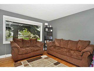 Photo 12: 553 REGAL Park NE in CALGARY: Renfrew Regal Terrace Townhouse for sale (Calgary)  : MLS®# C3570171