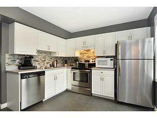 Photo 7: 553 REGAL Park NE in CALGARY: Renfrew Regal Terrace Townhouse for sale (Calgary)  : MLS®# C3570171