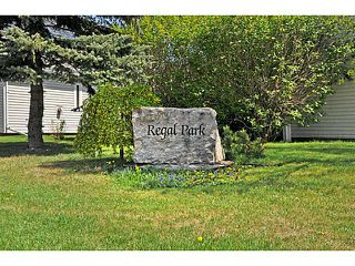 Photo 2: 553 REGAL Park NE in CALGARY: Renfrew Regal Terrace Townhouse for sale (Calgary)  : MLS®# C3570171
