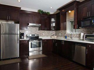 Photo 4: 1822 ISLAND AV in Vancouver: Fraserview VE House for sale (Vancouver East)  : MLS®# V1009385