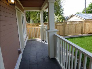Photo 2: 2051 E 1ST Avenue in Vancouver: Grandview VE 1/2 Duplex for sale (Vancouver East)  : MLS®# V1078042