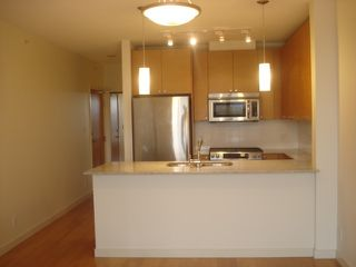 "Photo 3: 1401 400 CAPILANO Road in Port Moody: Port Moody Centre Condo for sale in ""ARIA2"" : MLS®# R2479307"