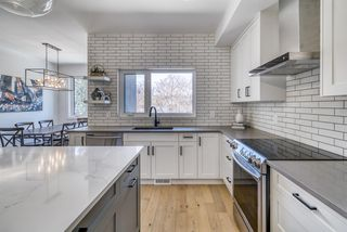 Photo 11: 94 23 Street NW in Calgary: West Hillhurst Row/Townhouse for sale : MLS®# A1035379