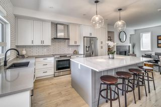 Photo 9: 94 23 Street NW in Calgary: West Hillhurst Row/Townhouse for sale : MLS®# A1035379