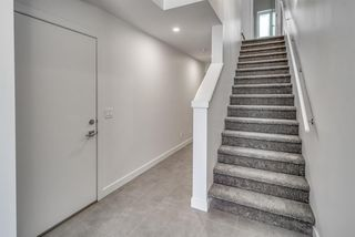 Photo 4: 94 23 Street NW in Calgary: West Hillhurst Row/Townhouse for sale : MLS®# A1035379